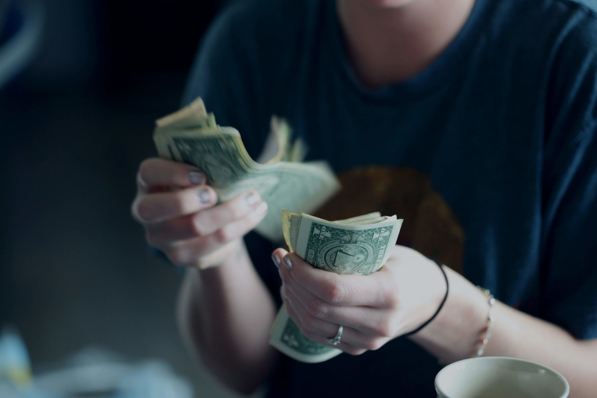 Woman counting bunch of dollars
