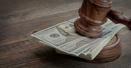 judge gavel and money on wooden table