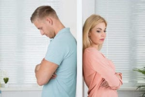 unhappy frustrated couple standing back to back